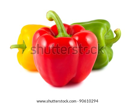 Three sweet peppers in red, yellow and green color - stock photo