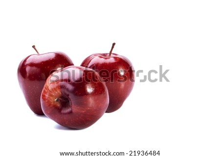 Three sweet red apples on white background