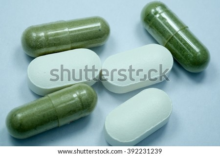 Three tablets and three capsule. isolated