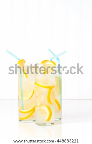 Three tall glasses of ice cold homemade lemonade. - stock photo