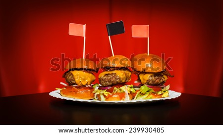 Three tasty mini burgers at the nice club restaurant - stock photo