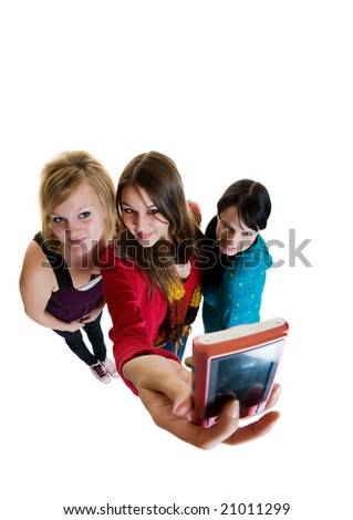 Three teenage friends taking a picture of themselves