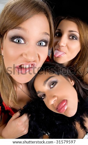 Three teenage girls making bizzare faces