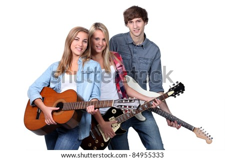 Three teenage guitar players - stock photo