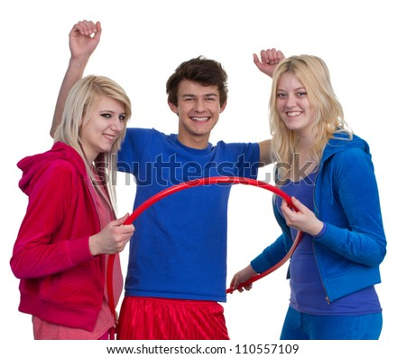 Three teenagers having fun with a sports hoop, isolated on white
