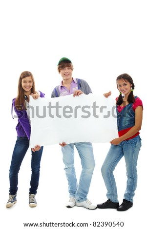 Three teenagers in casual clothes holding blank sheet of paper - stock photo
