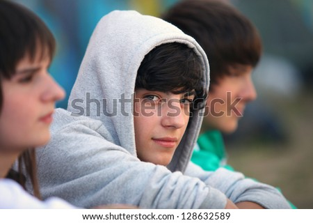 Three teenagers sat together - stock photo