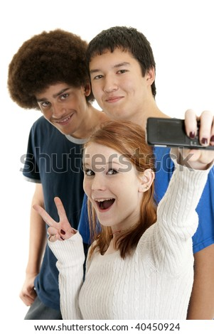 Three teens of different ethnic backgrounds smiling for the camera phone - stock photo