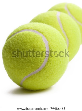 Three tennis balls isolated on white background with soft shadow. - stock photo