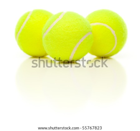 Three Tennis Balls with Slight Reflection Isolated on a White Background. - stock photo
