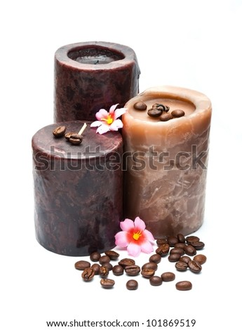 Three thick candles with flowers and coffee beans. - stock photo