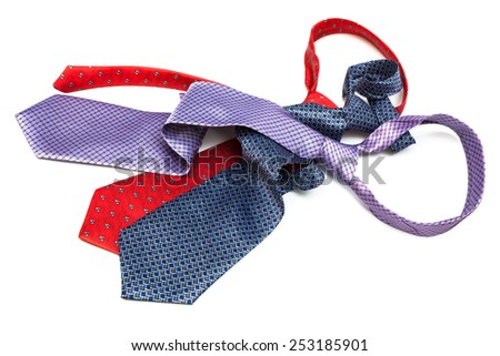 three tie knotted on a white background - stock photo
