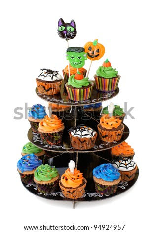 Three tier cupcake stand with lollipops on the top - stock photo