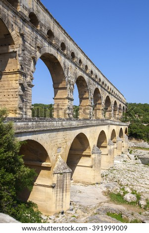 Three-tiered aqueduct Pont du Gard was built in Roman times on the river Gardon - France