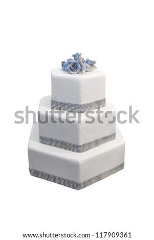 Three tiered wedding cake decorated with diamonds, isolated on white