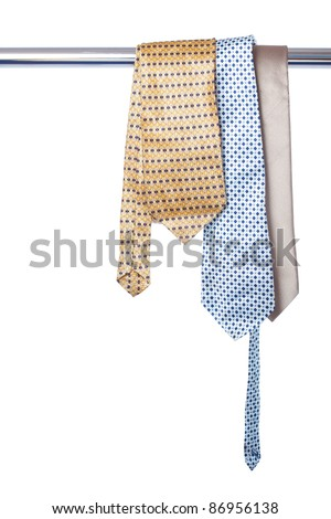 Three ties hanging on the tube isolated on white - stock photo