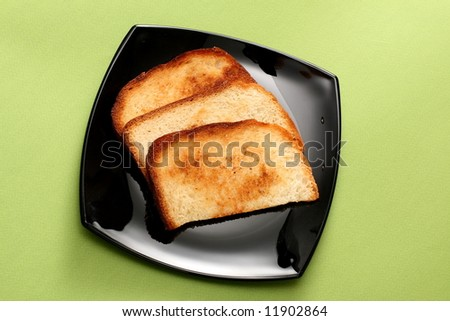 Three toasts on the black plate