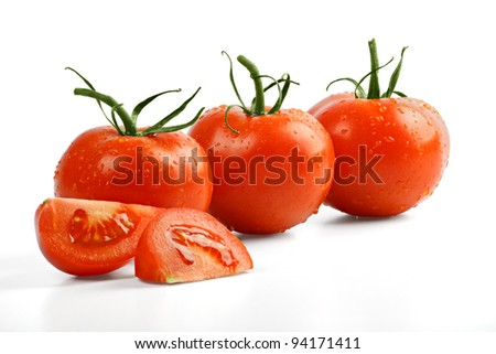 Three tomatoes with slices isolated on white with clipping path included