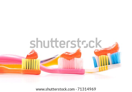 Three Tooth Brushes with Tooth Paste - stock photo