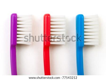 three toothbrushes white background - stock photo