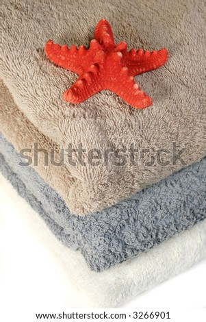 Three towels, isolated on white - stock photo