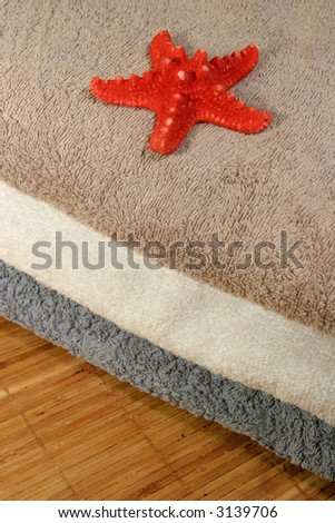 Three towels on a bamboo mat