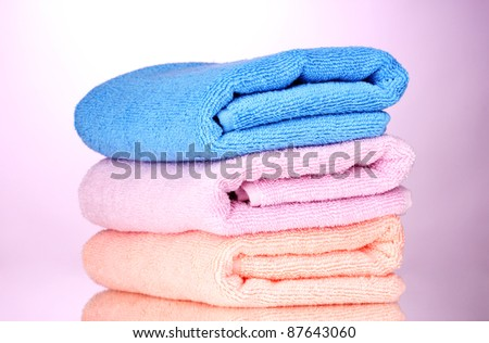 three towels on pink background