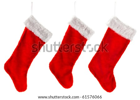 Three traditional fur red Christmas stocking. Isolated on white. - stock photo