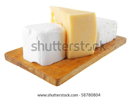 three types of cheeses on small wooden board