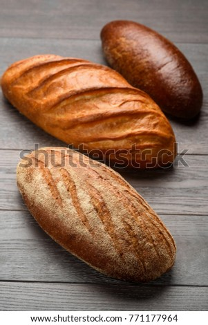 Three Types Of French Bread On Wooden Table Beautiful Loaves With Crispy Crust Baked