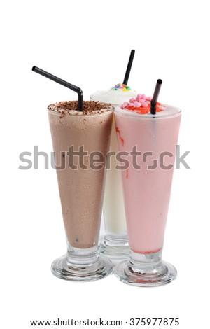 three types of milkshake drink on white background - stock photo