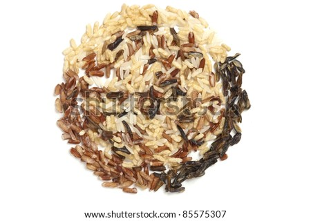 Three types of rice in a circle filled with wild rice. - stock photo
