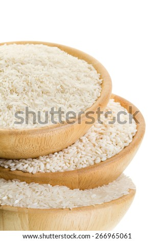 Three types of rice in a wooden bowl on a white background (close-up) - stock photo