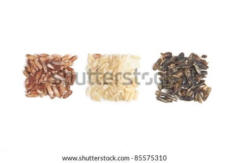 Three types of rice in square piles isolated on white. - stock photo