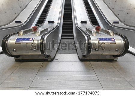 Three underground escalators in parallel layout - stock photo