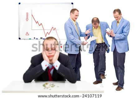 Three unhappy employees, angry at their indecisive boss, in front of a whiteboard showing a negative graph, representing the state of a business in financial crisis - stock photo