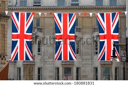 Three Union Jack flags in London, UK - stock photo