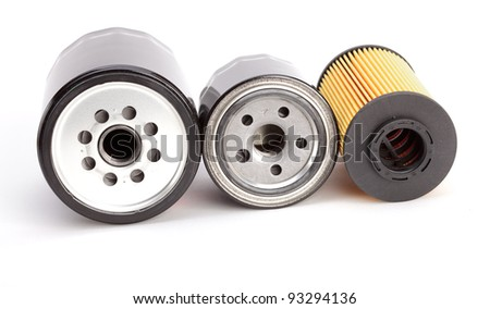 Three unique oil filters for modern autos isolated on a white background - stock photo