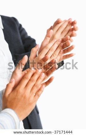 Three unrecognizable people giving applause over white background