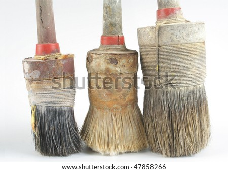 three used brushes - stock photo