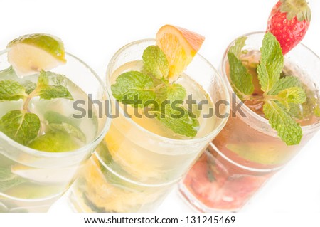 Three variation of Mojito top view close up,  a Cuban cocktail made with cuban rum, lime, sugar, a splash of soda and flavoured with fresh fruit of your choice - stock photo