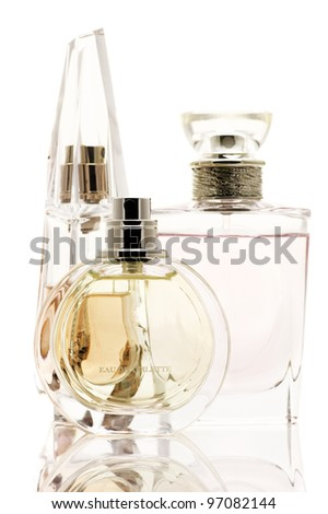 Three various female perfumes isolated on white background. - stock photo