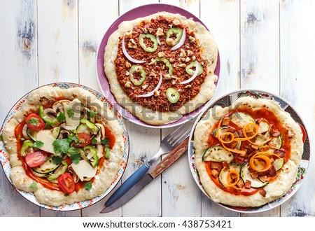 Three vegetable pizzas - stock photo