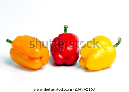 Three vegetables peppers in red, yellow, orange - stock photo