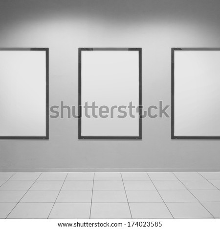 Three vertical poster on textured wall. Blank template - stock photo