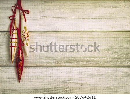 Three Vintage Christmas Ornaments Hanging on Rustic White Board Background with room or space for copy, text, words.  Horizontal instagram still life for cards or invitations. It has some grain - stock photo