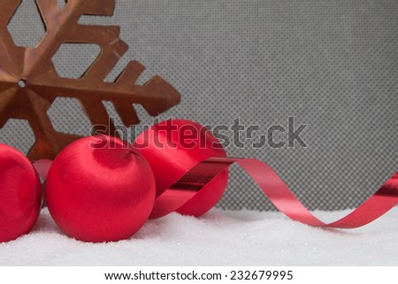 Three vintage christmas ornaments with ribbon and a star on a grey background - stock photo