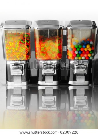 Three vintage gumball machines in a row - stock photo