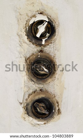 three vintage light switches in a row - stock photo