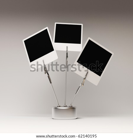 three vintage photography with pinces on grey background - stock photo